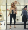 Quick change artist! Mariah Carey blows through THREE OUTFITS during