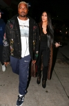 Kim Kardashian wears long fur coat as she steps out for romantic dinner