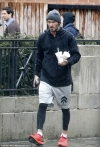David Beckham cuts a casual appearance in sporty gym ensemble as he leaves Barry's