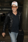 Father-to-be George Clooney sports leather jacket