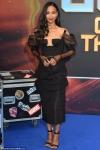 Zoe Saldana flaunts her slender figure in sexily sophisticated plunging black dress