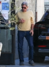 Harrison Ford cuts a casual figure as he wears a yellow crewneck sweater