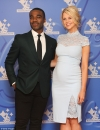 Ore Oduba poses proudly with his pregnant wife Portia at the National Lottery Awards...