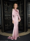 Amanda Holden oozes glamour in pink satin gown as she braves the elements