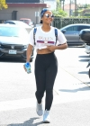 Christina Milian flashes toned torso in statement