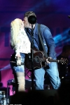 Blake Shelton kisses Gwen Stefani onstage during concert at the opening