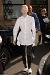 Tilda Swinton, 56, embraces her trademark androgynous style as she rocks an oversized shirt