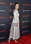 Olivia Wilde and Dakota Fanning wear glamorous gowns on the red