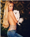 Paris Hilton poses topless on Instagram...covered only by her beloved