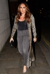 Busty Tamara Ecclestone selects a sexy ensemble from her £5million