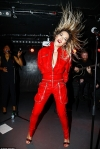 Lively Rita Ora flashes major cleavage in racy unzipped jumpsuit...