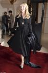 Kylie Minogue flashes her slender pins in chic chiffon midi dress