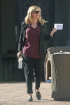 'Pregnant' Kirsten Dunst conceals belly underneath suit and baggy