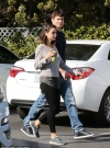 Mila Kunis and husband Ashton Kutcher coordinate in casual