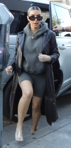 Kim Kardashian shows off her toned legs in biker shorts and leather