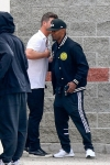 Jamie Foxx carries THREE cell phones as he meets up with Robin Thicke