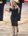 Fergie displays hourglass figure in a black lace dress... as she's slammed
