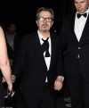 Award winner Allison Janney ditches her painful heels to go barefoot and Best Actor Gary