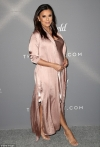 Pregnant Eva Longoria showcases her baby bump in pale pink satin at Costume Designers