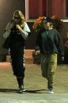 Kristen Stewart and Stella Maxwell wear matching sweatpants ensembles