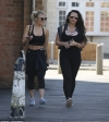 Danielle Armstrong flaunts her toned abs in a sports bra as she heads