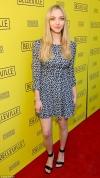 Amanda Seyfried flaunts legs in patterned mini dress and black