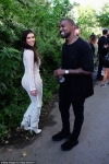 Kanye West cuts call with wife Kim Kardashian short to have warm