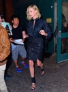 Charlize Theron flashes her toned legs in skimpy black miniskirt