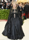 Madonna is a Gothic queen covered in crosses and a net veil at Catholic themed Met Gala