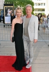 Sting and wife Trudie Styler cuddle up on the red carpet at the American
