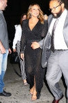 Mariah Carey oozes glamour in a plunging glittering gown in New York