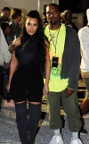 Kim Kardashian looks every inch the proud wife as she supports