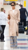 Victoria Beckham arrives solo at JFK Airport in NYC after celebrating