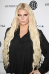 Jessica Simpson defends video of her husband flipping their son