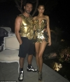 Irina Shayk flaunts cleavage and long legs in gold metallic dress