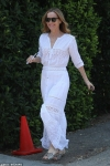 Leslie Mann wears figure-hugging broderie anglaise dress to annual Day