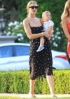 Rosie Huntington Whiteley looks like a vision in spotted sundress during