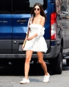 Emily Ratajkowski puts on a flirty display in a mini dress while