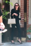 Angelina Jolie swaps white look for all-black as she steps