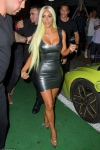 Kim Kardashian debuts neon GREEN locks and shows off her bulbous buttocks in a VERY