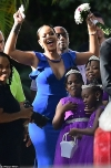 Rihanna flaunts her ample cleavage while playing the ultimate bridesmaid