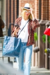 Naomi Watts cuts a casual figure in flowing jeans as she dotes