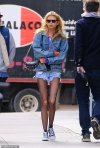 Stella Maxwell rocks a denim jacket and shorts with ripped tights