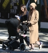 Shayk smiles as she steps out with daughter Lea for a stroll in NYC...