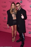 Behati Prinsloo is joined by Maroon 5 rocker husband Adam Levine at Victoria's Secret after