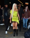 Rita Ora slips into a slinky lime green minidress in her THIRD outfit change