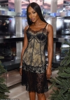 Naomi Campbell, 48, flaunts her age-defying figure in black lace