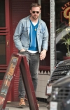 Ryan Gosling is ruggedly handsome in denim jacket and faded jeans as he