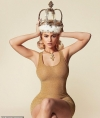 Kylie Jenner poses as the QUEEN in skintight gold bodycon dress
