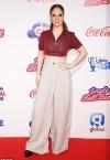 Jess Glynne suffers wardrobe malfunction as she accidentally